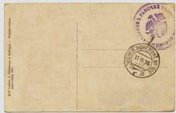 Detrás de una postal de la vendimia con los matasellos Imagen de archivo libre de regalías