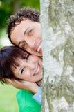 Detrás del árbol Fotografía de archivo