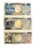 Detrás del dinero japonés Imagenes de archivo