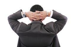 Hombre de negocios que lleva a cabo las manos en la cabeza Imagen de archivo libre de regalías