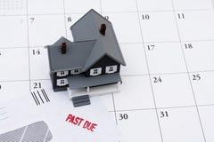 Detrás en de sus pagos de hipoteca Imagen de archivo libre de regalías