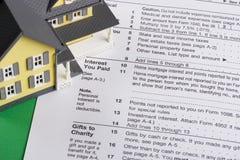 Detrazione delle imposte di interesse da contratto ipotecario Fotografie Stock