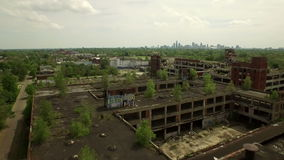 Detroit Aerial. V64 Flying low over abandoned old Packard Plant towards downtown