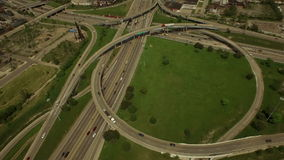 Detroit Aerial. V55 Flying low over Interstate 94 and 75 intersection panning down to vertical shot