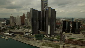 Detroit Aerial. V30 Flying low over Detroit River panning left with cityscape views