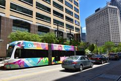 Detroit QLine Woodward. DETROIT, MI / USA - JUNE 30, 2019:  QLine buses, such as the one shown here, travel along Woodward Avenue in downtown Detroit stock photo