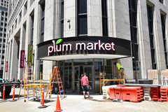 Detroit Plum Market construction. DETROIT, MI / USA - JUNE 30, 2019:  Workers work on the facade of the new Plum Market in downtown Detroit, an example of the stock images