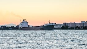 The TECUMSEH Bulk Carrier ship on the Detroit River. Detroit, MI, USA - 1 October 2016: The TECUMSEH Bulk Carrier ship on the Detroit River at dusk as viewed royalty free stock photo