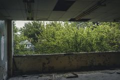 Detroit, Michigan, May 18, 2018: Interior view of abandoned and damaged George Ferris School in Detroit. Like other. Schools in Highland Park, Ferris went into royalty free stock image