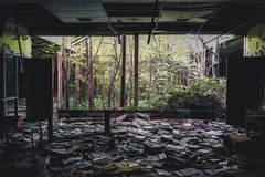 Detroit, Michigan, May 18, 2018: Interior view of abandoned and damaged George Ferris School in Detroit. Like other. Schools in Highland Park, Ferris went into stock photography