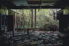 Detroit, Michigan, May 18, 2018: Interior view of abandoned and damaged George Ferris School in Detroit. Like other. Schools in Highland Park, Ferris went into stock photo