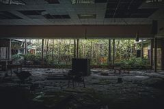 Detroit, Michigan, May 18, 2018: Interior view of abandoned and damaged George Ferris School in Detroit. Like other. Schools in Highland Park, Ferris went into royalty free stock images