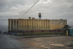 Detroit, Michigan, May 18, 2018: View towards abandoned Detroit Automotive Factory with water tower and Chimney. Photo taken in the USA stock photo