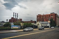 Detroit, Michigan, May 18, 2018: View towards typical Detroit Automotive Factory with water tower and Chimney. Photo taken in the USA royalty free stock image