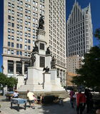 Detroit Park and Monument. Detroits Michigan Soldiers and Sailors Monument (background left) is a four-tier monument that uses granite shafts, many of them stock image