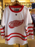 The Detroit Red Wings jersey on display at NHL store Stock Image
