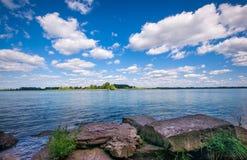 Detroit River shoreline. South end of Detroit river rocky shoreline stock image
