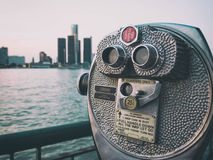 Detroit Sightseeing Skyline. Sightseeing tourist binoculars overlooking downtown Detroit, Michigan on a summer afternoon from Windsor, Ontario, Canada stock photography