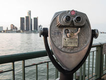 Detroit Sightseeing from Windsor. Sightseeing tourist binoculars overlooking downtown Detroit, Michigan on a summer afternoon from Windsor, Ontario, Canada royalty free stock image