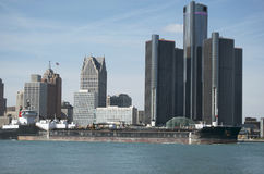 Detroit Skyline With Barge. Detroit skyline with a barge in the foreground which illustrates the shipping route that passes near the city, as part of the St stock photos