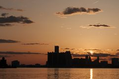 Detroit skyline. Right after sunset with orange glow royalty free stock image