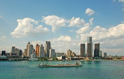 Detroit skyline and riverfront. Downtown skyline, waterfront and barge royalty free stock image