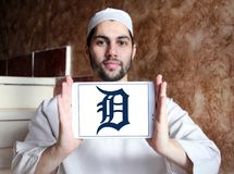 Detroit Tigers baseball team logo. Logo of Detroit Tigers team on samsung tablet holded by arab muslim man. The Detroit Tigers are an American professional Royalty Free Stock Images
