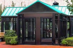 An outdoor glass prayer sanctuary at the Casey Solanus Center. Detroit, USA - October 2nd, 2016: An outdoor glass prayer sanctuary containing statues of Jesus stock photos
