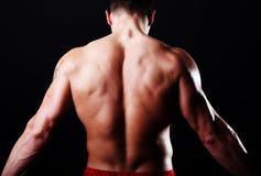 Detrás del deportista atractivo Imagenes de archivo