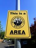 Detta ?r ett tecken f?r omr?de f?r Neighbourhoodklocka royaltyfria bilder