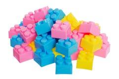 Dettagli colorati del progettista di plastica dei bambini su una b bianca Immagini Stock Libere da Diritti