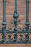 Dettagli del primo piano di un recinto del ferro battuto Fotografia Stock