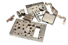 Dettagli di CNC del metallo. Matrice e rivestimento. Fresatura e perforazione ind Fotografia Stock