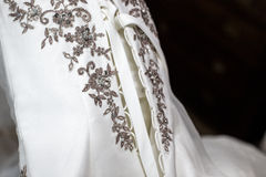 Dettagli di un vestito da sposa Fotografia Stock