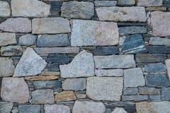 Dettagli di una parete fatta dalle vecchie pietre fotografia stock libera da diritti