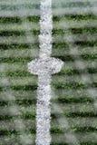 Dettaglia gli sport della sfera di calcio di scena Fotografie Stock