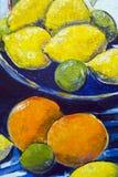 Dettaglio alto di fine originale della pittura a olio - limoni e limette fotografia stock