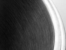 Dettaglio astratto nella fine su di una pentola parzialmente 2 di acciaio inossidabile immagine stock libera da diritti
