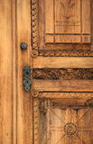 Dettaglio complesso in vecchia porta di legno Fotografia Stock
