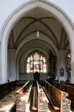 Dettaglio dei banchi di chiesa di legno scolpiti in una chiesa Fotografie Stock Libere da Diritti