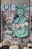 Dettaglio dei graffiti sulla barriera di separazione fra la Palestina e Israele fotografia stock libera da diritti