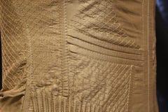 Dettaglio del corsetto dell'oro Fotografie Stock