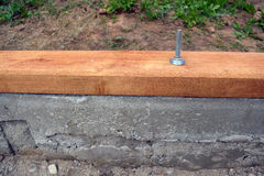 Dettaglio del fondamento della Camera con la plancia e l'ancora di legno Fotografie Stock Libere da Diritti