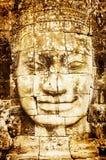 Dettaglio del fronte di pietra d'annata nel tempio di Bayon a Angkor Wat Fotografie Stock