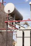 Dettaglio del serbatoio dell'olio su un trasformatore ad alta tensione Fotografia Stock Libera da Diritti