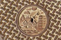 Dettaglio della botola decorata tradizionale della fogna a Bergen, Norvegia Fotografia Stock Libera da Diritti