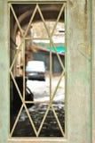 Dettaglio della finestra del portone Fotografie Stock Libere da Diritti