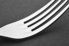 Dettaglio della forcella sopra un fondo nero cutlery Fotografia Stock Libera da Diritti