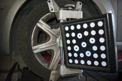 Dettaglio della macchina fotografica della macchina di allineamento di ruota Fotografie Stock