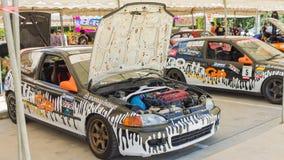 Dettaglio delle vetture da corsa e parte del motore di automobile fotografia stock libera da diritti